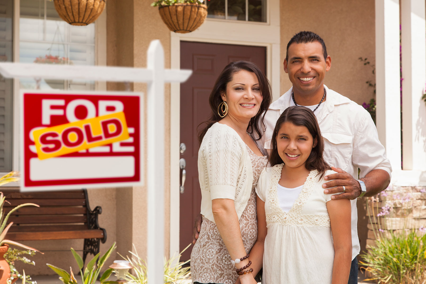 Family in front of a sold home
